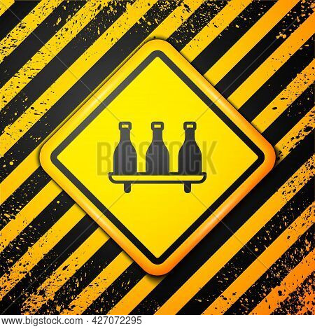 Black Bottle Of Wine Icon Isolated On Yellow Background. Wine Varieties. Warning Sign. Vector