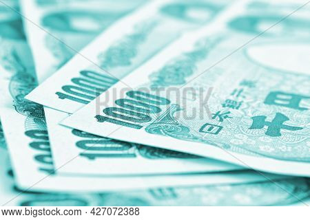 Close-up Of Several Japanese 1,000 Yen Bills. Light Turquoise Tinted Backdrop. Background About Mone