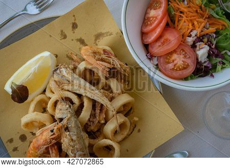 Assorted Fried Fish, Squid, Shrimps And Mixed Salad