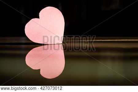 Pink Paper Heart Shape With Dark Black And White Bakground. Couple Melancholy Regret Disappointed Cr