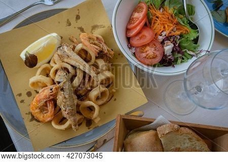 Assorted Fried Fish, Squid, Shrimps, Mixed Salad And Bread