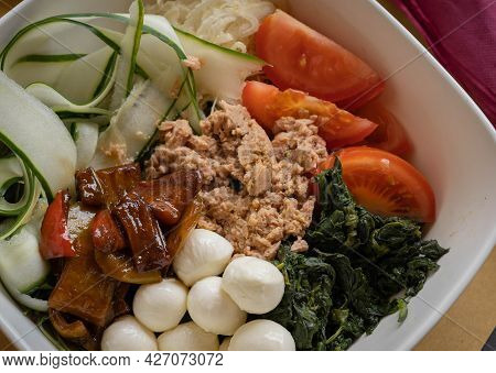 Image Of Assorted Fresh Vegetables, Tuna, Mozzarella And Baked Peppers In A Deep White Bowl