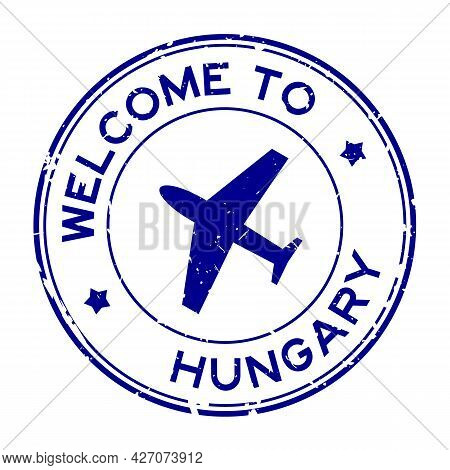 Grunge Blue Welcome To Hungary Word With Airplane Icon Round Rubber Seal Stamp On White Background