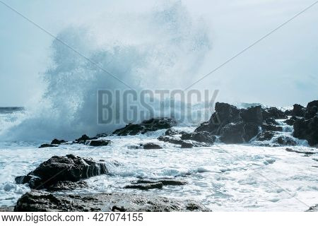 Scenic Coast Rush Force. Powerful Ocean Wave Splashes Across A Big Rock In The Middle Of The Rough S