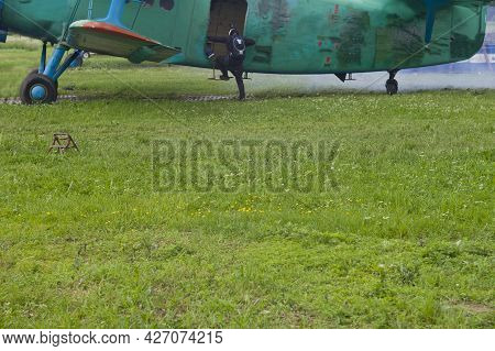 A Parachuter Climbing Ino A Plane Ready To Take Off, Focus In The Foreground