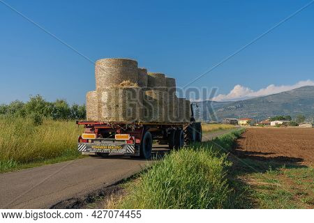 Tractor Transporting Sheaves In The Fields In The Province Of Latina, Fronzinone In Italy