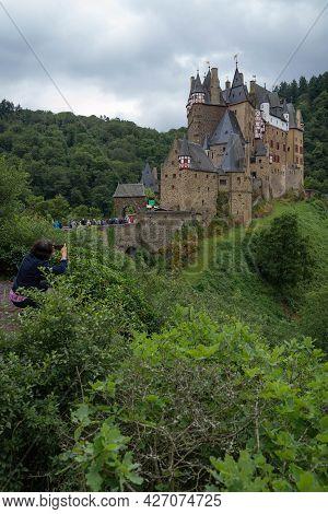 Woman Photographing Eltz Castle Near Koblenz, Germany