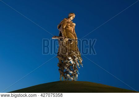 Rzhev, Russia - July 07, 2021: Sculpture Of A Soviet Soldier Close-up July Night. Memorial In Honor