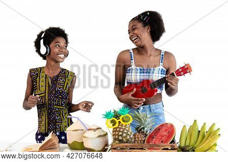 Two Children Dark Skinned Plays Ukulele On Summer Vacation. African American Boys And Girls Enjoy Ea