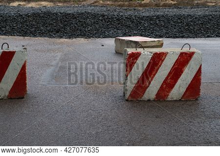 In Connection With The Road Works, The Road Is Closed With Reinforced Concrete Slabs Painted In A Wa