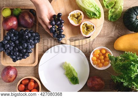 Hands Of Woman Preparing Fresh Fruits And Vegetables For Vegan Food Cooking On Wooden Table, Healthy