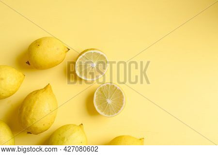 Fresh Lemon On Yellow Color Background, Flat Lay, Top View
