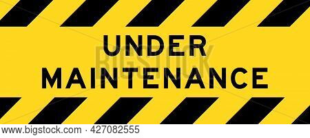 Yellow And Black Color With Line Striped Label Banner With Word Under Maintenance
