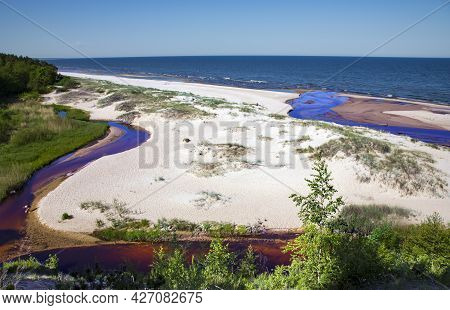 The Small Freshwater Peterupe River Flows Into The Baltic Sea Near The White Dune In Saulkrasti, Lat
