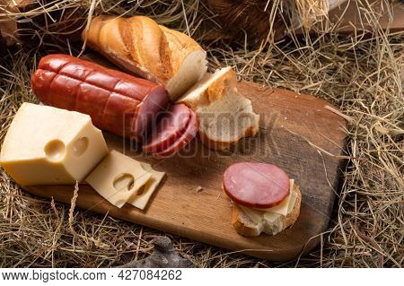 Meat And Cheese Cuts. Homemade Cheese And Meat. Rustic Style. Variety Of Cheese And Meats On A Cutti
