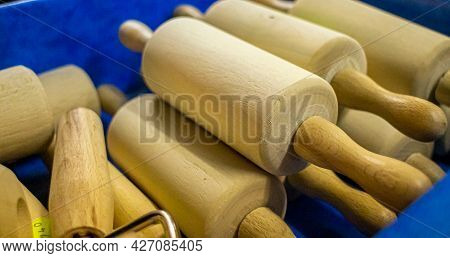 Several Wooden Rolling Pins At A Stall Selling Household Goods At A Regional Market