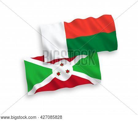 National Fabric Wave Flags Of Burundi And Madagascar Isolated On White Background. 1 To 2 Proportion