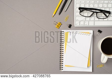 Top View Photo Of Workstation Glasses On Keyboard Cup Of Coffee Stationery Binder Clips Pencil Pens