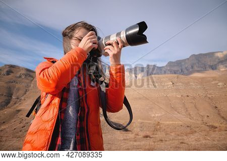 Caucasian Woman Landscape Photographer With Big Lens And Professional Camera Takes Pictures In Mount