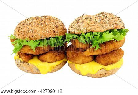 Breadcrumb Covered Chicken Fillet Sandwiches In Multigrain Seed Covered Bread Rolls Isolated On A Wh