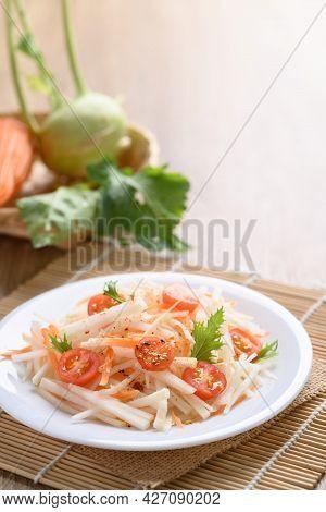 Salad With Sliced Kohlrabi, Carrot, Tomato And Mizuna Leaf On White Dish, Vegan Food, Healthy Eating