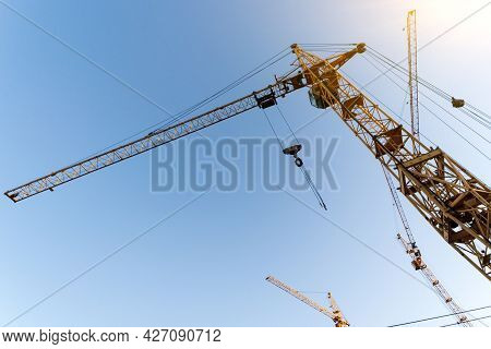 Construction Crane. Huge Crane Against Blue Sky. Self-erection Cranr. Tower Crane.