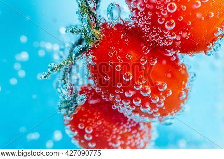 Fresh Organic Red Baby Plum Tomatoes Baby Tomato, Cherry Tomato In The Water Close-up