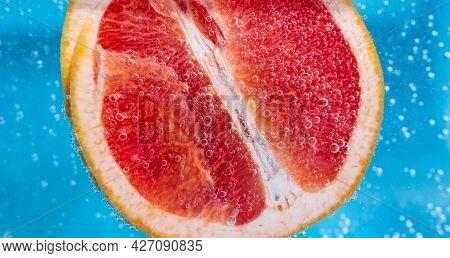 Grapefruit Close Up Macro, Under Water, For Juice. Ripe Juicy Fruit In Water