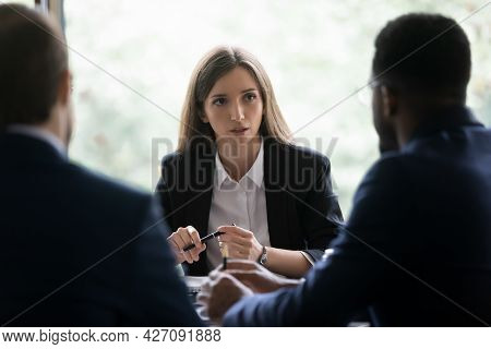 Serious Businesswoman Discussing Deal With Customers, Business Partners