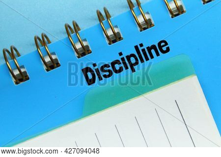 Notebook With The Word Discipline And A Light Blue Background