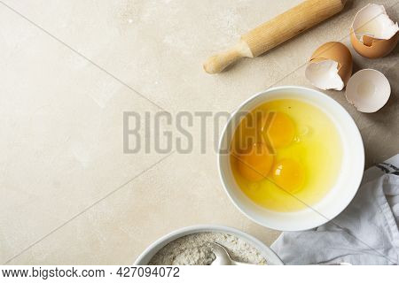 Baking, Pastry Cooking At Home Concept. Eggs, Flour Rolling Pin For Cooking Delicious Food Or Desser