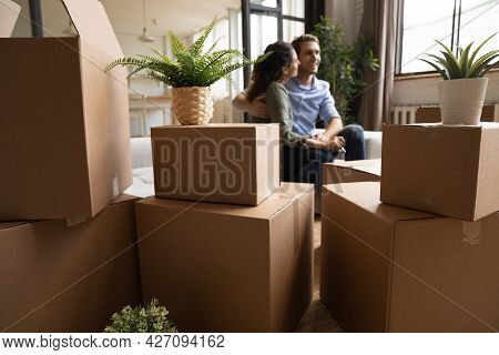 Young Couple First Time Realty Buyers Hug At New Home