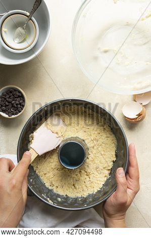 Female Hands Cooking Bundt Cake In Bundt Tin Metal Pan, Raw Cake Dough
