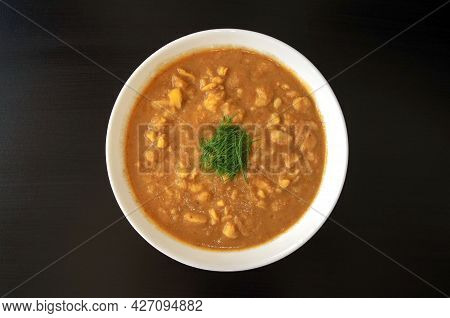 Arabic Cuisine - Plain Peeled Fava Beans In A White Bowl On A Dark Brown Background. Top View. Foul