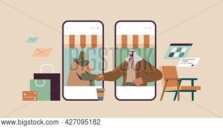 Arab Businesspeople Shaking Hands Business Partners On Smartphones Screen Making Deal Agreement Hand