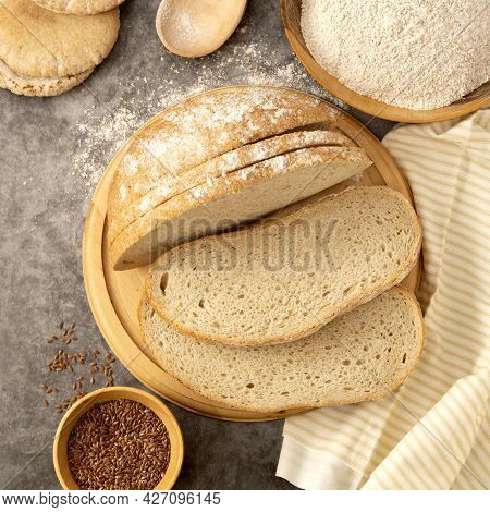 Whole Grain Round Bread On Dark Background. Top View. Freshly Baked Bread.