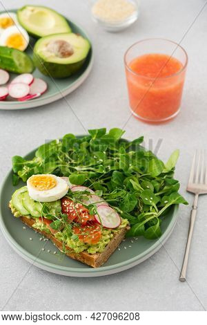 Sandwich With Avocado, Salmon And Vegetables