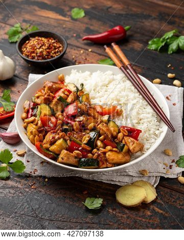 Kung Pao Chicken With Peppers, Zucchini And Rice. Asian Take Away Food