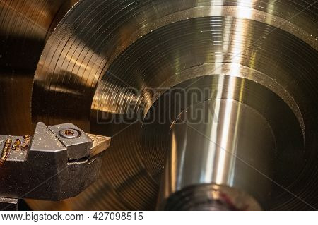 The Lathe Machine Finishing Process Cut The Brass Shaft Material. The Metalworking Process By Turnin