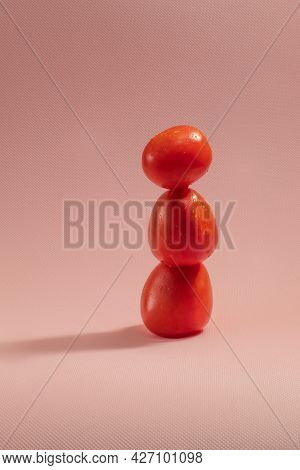 The Photo Shows An Image Of Ripe And Juicy Tomatoes Of An Oval Shape Of Red Color. Raw And Whole Tom