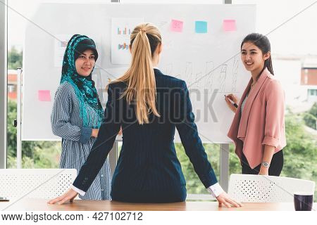 Multicultural Working Group. Team Of Businesswomen Of Different Ethnicity, Caucasian, Asian And Arab