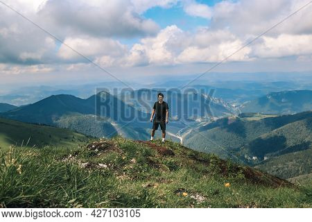 Athlete In A Black T-shirt Poses On Top Of The Mala Fatra Mountain. Climbing Mount Hromova. A Hiker