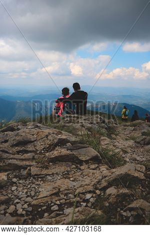 Couple In Love Sitting On A Viewpoint In The Low Tatra Mountains In Slovakia. The Bond Between Two P
