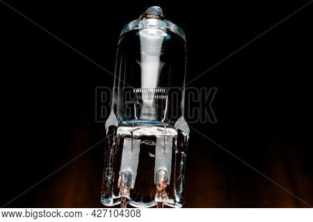 Several Halogen Small Incandescent Lamps With A Blurry Background