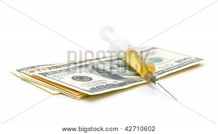 Syringe And The U.s. Currency (dollars) On A White Background