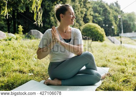 Happy Young Woman Professional Yogi Practicing Meditation Performing Exercise Marichi Sage Pose, Out