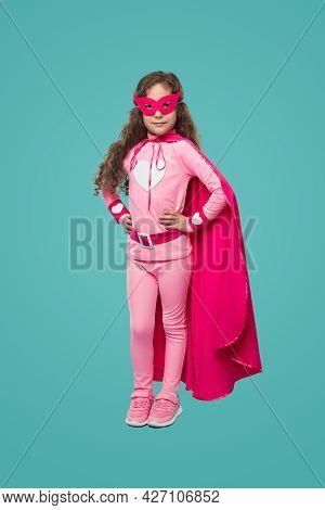 Full Body Of Curly Haired Girl In Pink Masquerade Mask And Superhero Costume With Heart Emblem Keepi