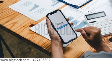Chiang Mai, Thailand - July 18, 2021: Woman Holding Iphone 11 With Instagram App On Screen At Workin