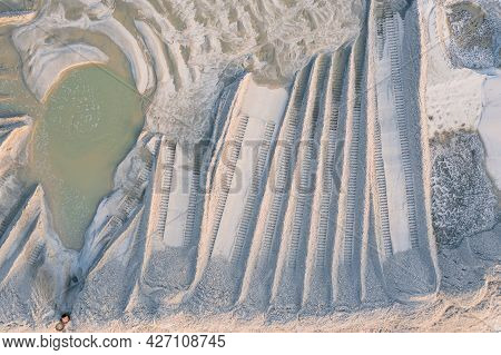 Muddy Sand With A Dredger. River Sand Mining Site Hydro-wetting. Bulldozer Tracks On Washed-up River