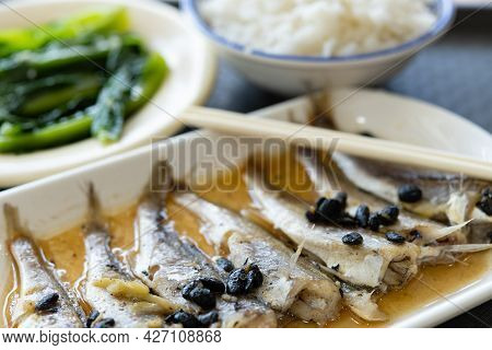 Angle View Fast Food Of Small Fishes With Vegetable And Rice Horizontal Composition